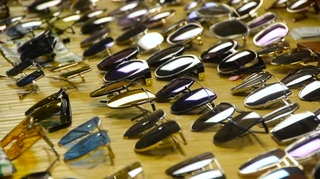 Collection of sunglasses on the counter, Large selection of sunglasses