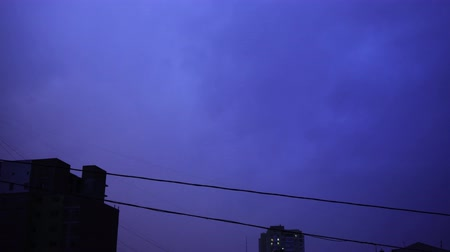 electric strike : Lightning in the night sky in the city, a bright flash of light in the clouds in the rain, a thunderstorm