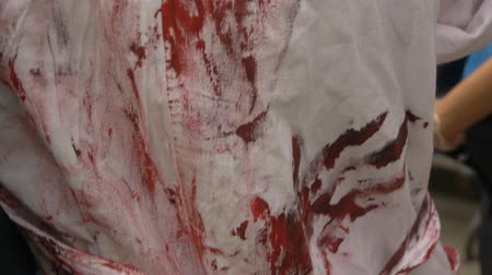 blood drop : Prints of bloody hands on a medical dressing gown, halloween