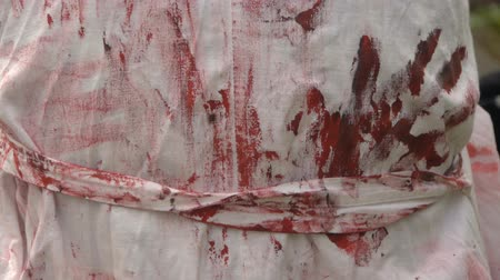 bloody hands : Prints of bloody hands on a medical dressing gown, halloween