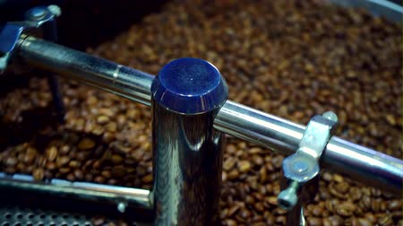 roaster : Cooling coffee beans after roasting. Roasting machine, close-up