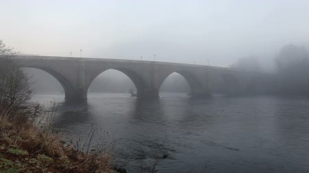 Dunkeld Bridge over River Tay in fog Scotland Stock Footage