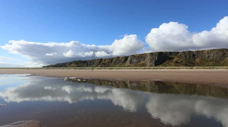 Cliffs reflected St Cyrus Nature Reserve Aberdeenshire Scotland Stock Footage