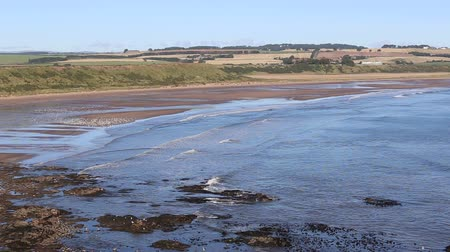 Elevated view of Lunan Bay Angus Scotland Stock Footage