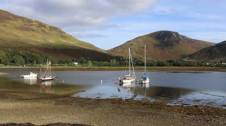 Peak of Torr Nead an Eoin and sailing boats in Loch Ranza, Lochranza Isle of Arran Scotland