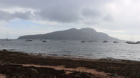 Yachts moored in Lamlash Bay with Holy Isle, Arran Scotland