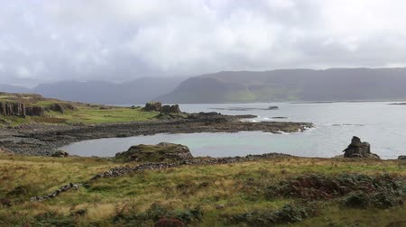Loch na Keal with mountains of Mull viewed from Ulva Scotland Stock Footage