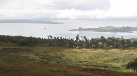 Timelapse of elevated view of ferry passing Duart Castle, Isle of Mull, Scotland Stock Footage
