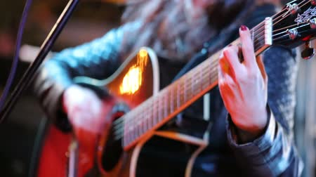 serenade : Womans hands playing acoustic guitar on concert. Close up