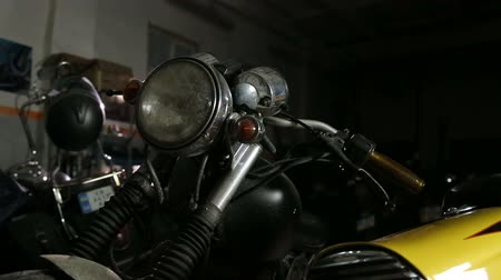 Old dirty motorcycle before reparing and redesigning in workshop