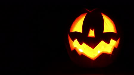október : Jack-o-lantern with Candles inside Lattern HD background Footage in  full Dark