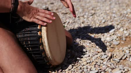 davulcu : Djembe traditional Drum Player beat rythm on the lonely beach