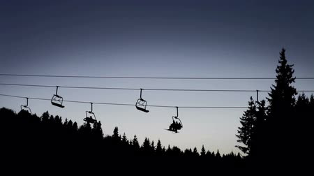 esqui : Ski Lift in High mountains at the late evening Stock Footage