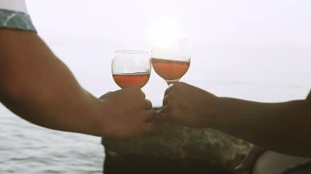 társkereső : Clinking wineglasses on the wild sunny seaside