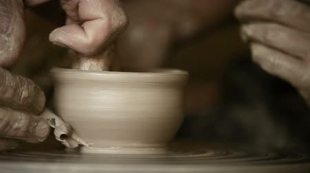 potter wheel : Old Potter works in workshop Stock Footage