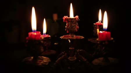 готический : Candles in candelabrum with five branches in full dark Стоковые видеозаписи