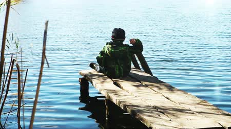 throwing in : Alone boy throw rocks in the lake water
