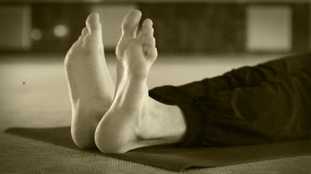 male : Yoga man warming up foot exercise