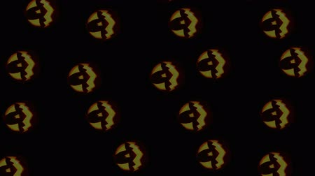 dynia : Army of Jack-o-lanterns rolling on the black background Wideo