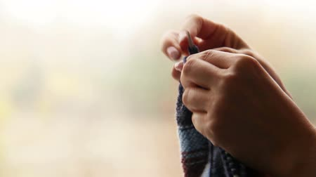 příze : Womans hands knitting with blurry autumn background  High Definition Video : 29.97 FPS 29sec  Please look another footages on my TrainArrival Account. Best Wishes.