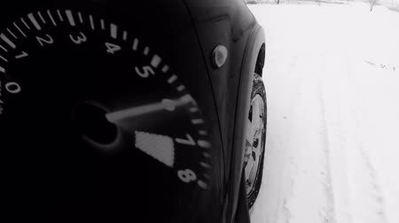 wayside : Winter road front car wheel extreme driving video tacho  Hight Definition Video : 23.98 FPS 41sec   Please look another footages   on my Train_Arrival Account.     Best Wishes. Stock Footage