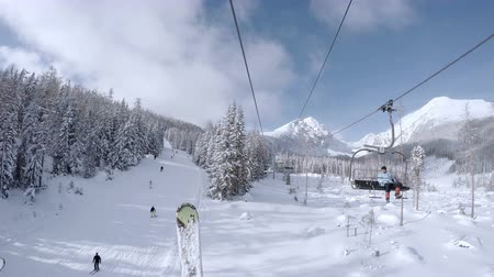 chair lift : 4K UHD Video: Ski lift in snowy Tatras Mountain resort