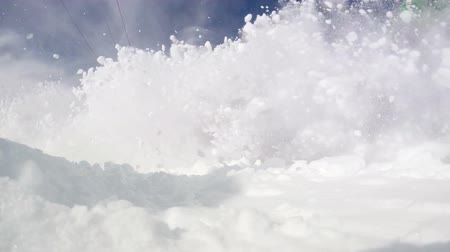 agresif : Aggressive Skier splashing snow into camera slow motion video Stok Video