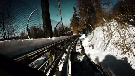rolete : Grunge-styled footage: Winter Bobsleigh Roller coaster attraction.  4K Ultra UHDTV 3840X2160 : 29.97 FPS 19sec Please look another footages on my Train_Arrival Account.  Best Wishes.
