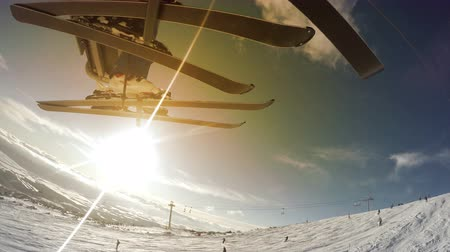 esqui : Skiers on the lift, beatiful sunny landscape on the background  4K Ultra UHDTV 3840X2160 : 29.97 FPS 6sec Please look another footages on my Train_Arrival Account.  Best Wishes. Stock Footage