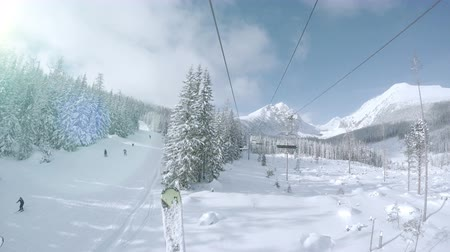extremo : 4K Footage: Ski lift in snowy Tatras Mountain resort  4K Ultra UHDTV 3840X2160 : 29.97 FPS 3sec Please look another footages on my Train_Arrival Account.  Best Wishes.