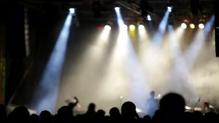 rock music : Rock concert stage with colored spotlights and smoke Stock Footage