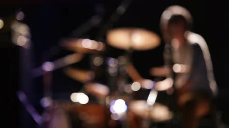 musicians stage : Rock concert: fast drummer movings, unfocused