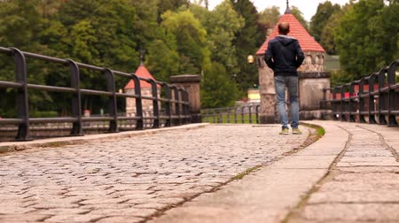macskaköves : Lonely man and a couple walk by the cobbled thoroughfare Liberec, Czech Republic High Definition Video: 23.98 FPS 14sec Please look another footages on my TrainArrival Account. Best Wishes Stock mozgókép