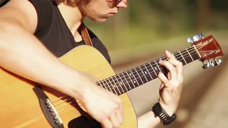 akustik : Acoustic Guitar long haired blond player Stok Video