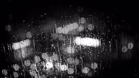 black yellow : City lights as seen through the window glass during the rain. Black and white footage.   Hight Definition Video : 29.97 FPS 24sec   Please look another footages with professional demo Exercises  on my TrainArrival Account.     Best Wishes. Stock Footage