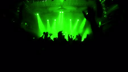 rock concert : Slow motion video of cheering crowd during rock-concert. Green spotlights illuminating the venue.  High Definition Video : 29.97 FPS  16sec Please look another footages on my TrainArrival Account.  Best Wishes. Stock Footage