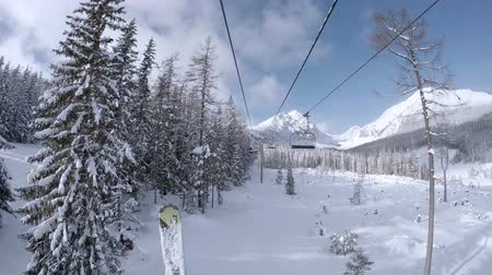 chair lift : 4K footage of a cableway moving to the mountains top in skiing resort  4K Ultra UHDTV 3840X2160 : 29.97 FPS 14sec Please look another footages on my TrainArrival Account.  Best Wishes.