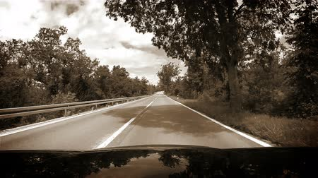 drive : Sepia toned footage of a car going down the road in the mountains - on the way to the Croatian Mediterranean coast