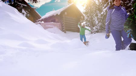 távozás : Happy family spending winter vacation in the mountain cabin with their dog  High Definition Video : 29.97 FPS 13sec Please look another footages on my TrainArrival Account.  Best Wishes.