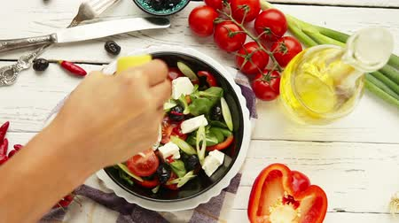 salad : Vegetarian low calorie Greek salad preparation top view lemon juice addition moment