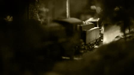 mozdony : Old film effect footage model railway with old-fashioned locomotive on the route  High Definition Video : 29.97 FPS 7sec Youll find our team on CreativePhotoTeam.com  site . Welcome :)  Best Wishes. Stock mozgókép