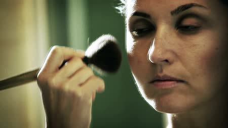 ator : Woman applying make-up in front of the mirror  High Definition Video : 29.97 FPS 11sec   Please look another footages on my Train_Arrival Account.  Best Wishes.