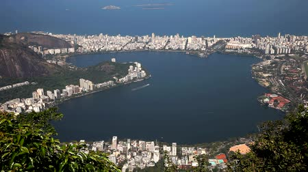 Рио : City of Rio de Janeiro, Brazil - Panoramic view from the statue of Christ Redeemer at the top of Corcovado Mountain with city of Rio de Janeiro and Guanabara Bay in the background. Стоковые видеозаписи