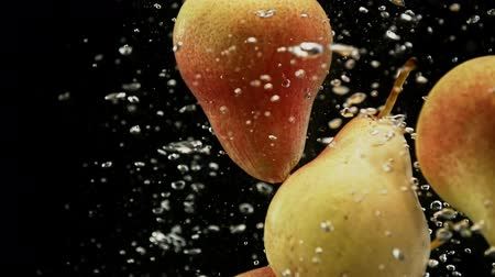 fructose : Fresh red and yellow pears fruits falling into water with splash and air bubbles