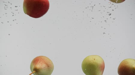 fructose : Fruits red and yellow pears apples falling into water with splash air bubbles