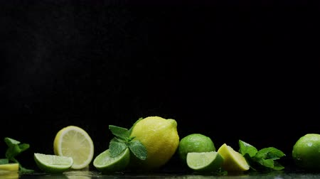 лимонный : Citrus fruits, lemon lime, mint leaves, small water drops, on the table prepared for juicy cocktail