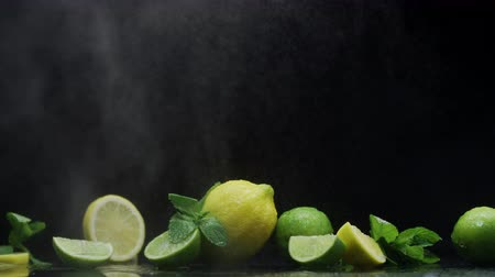 ferahlatıcı : Dewy citrus fruit lemon lime under water droplets on water surface prapared for refreshing cocktail