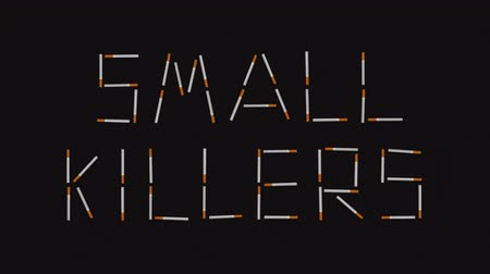 tobacco : Small killers words made of cigarettes. No smoking concept in stop motion