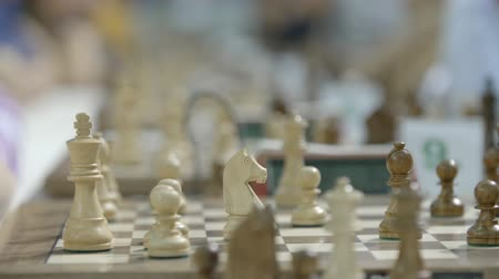 mastermind : Chessboard and figures at chess competition world cadets championship close-up