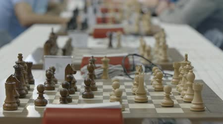 mastermind : Chessboard and figures at chess competition. Children play chess at world cadets championship Stock Footage